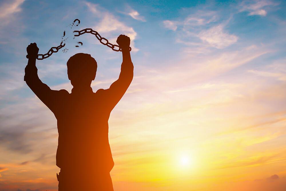 A man breaking chains